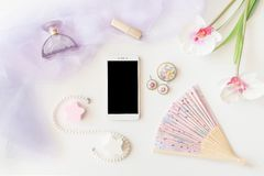 Beauty products, jewelry and Smartphone top view on white backgr Stock Photo