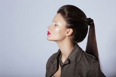 Beauty. Profile of Young Stylish Brunette with Tress Stock Photo