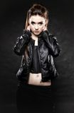 Beauty punk girl in leather, subculture. Subculture beauty punk girl in leather jacket black background Stock Photo