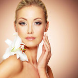 Beauty pure face of the young beautiful girl with flower Stock Photography