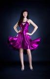 Beauty in purple dress Stock Images