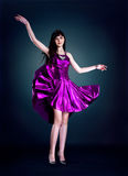 Beauty in purple dress Royalty Free Stock Images