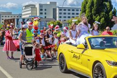 Beauty queen riding in a Christmas parade, followed by children stock photos