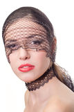 Beauty with red lips in black mask Stock Photography