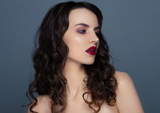 Beauty red lips makeup fashion model curly hair Royalty Free Stock Image
