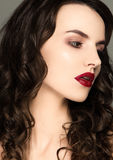 Beauty red lips makeup fashion model curly hair Stock Photography