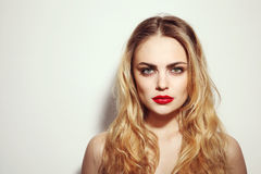 Beauty with red lips Stock Photography