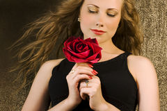 Beauty with red rose. And long hair Stock Photography