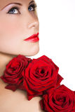 Beauty with red roses. Om white Royalty Free Stock Image