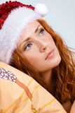 Beauty red woman in santa hat Stock Photo