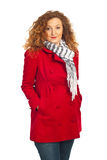 Beauty redhead woman in red jacket Royalty Free Stock Photography