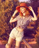 Beauty redhead woman smiling in the park, lifestyle, people. Beauty stylish playful smiling woman enjoying nature, relax, harmony, people, outdoors. Sunset in royalty free stock image