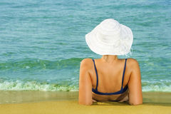 Beauty relaxing at beach Stock Images