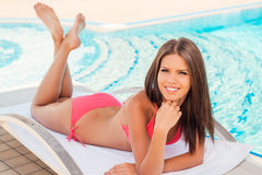 Beauty relaxing by the pool. Stock Photography