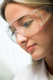 Beauty researcher. Young beauty woman in modern research laboratory Royalty Free Stock Image