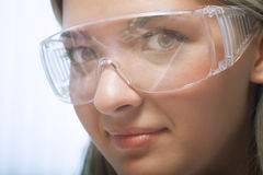 Beauty researcher. Young beauty woman in modern research laboratory Royalty Free Stock Images