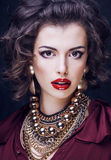 Beauty rich brunette woman with a lot of jewellery Stock Photos