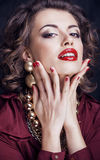 Beauty rich brunette woman with a lot of jewellery Stock Photography