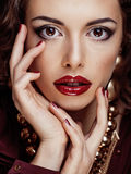 Beauty rich brunette woman with a lot of jewellery Royalty Free Stock Images