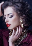 Beauty rich brunette woman with a lot of jewellery Stock Image