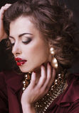 Beauty rich brunette woman with a lot of jewellery Royalty Free Stock Photos