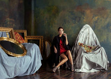 Beauty rich brunette woman in luxury interior near. Empty frames, vintage elegance royalty free stock photos