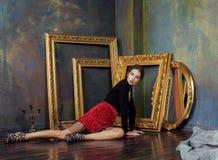 Beauty rich brunette woman in luxury interior near Royalty Free Stock Photo