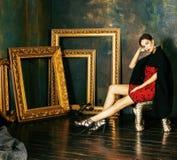 Beauty rich brunette woman in luxury interior near empty frames,. Vintage elegance royalty free stock photos