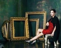 Beauty rich brunette woman in luxury interior near empty frames, vintage elegance brunette. Close up Stock Photo