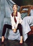 Beauty rich brunette woman in luxury interior near empty frames, vintage elegance Stock Photo
