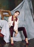 Beauty rich brunette woman in luxury interior near empty frames, vintage elegance hispanic, home alone Stock Image