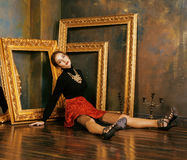 Beauty rich brunette woman in luxury interior near empty frames, vintage elegance hispanic, home alone. Art concept Royalty Free Stock Images
