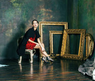 Beauty rich brunette woman in luxury interior near empty frames,. Wearing fashion clothes, lifestyle pretty real people concept royalty free stock images