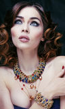 Beauty rich woman with luxury jewellery close up Stock Photography