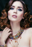 Beauty rich woman with luxury jewellery looks like Royalty Free Stock Image