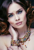 Beauty rich woman with luxury jewellery looks like. Mature close up Royalty Free Stock Image