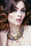 Beauty rich woman with luxury jewellery looks like Stock Images