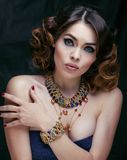Beauty rich woman with luxury jewellery looks like Stock Image