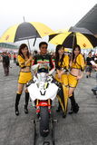 Beauty and the rider. Simon Kwan sitting on his Yamaha R6 with beautiful racing queen before the start of ZIC superbike race Stock Photography