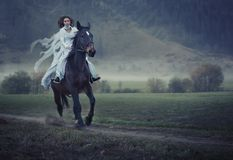 Beauty riding a horse. Sensual young beauty riding a horse Stock Photos
