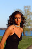 Beauty by the River. Beautiful model posing by the river stock photo
