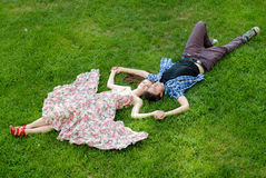 Beauty romantic couple embracing lying outdoors Stock Images