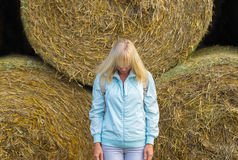 Beauty romantic girl outdoors against hay stack Royalty Free Stock Photo