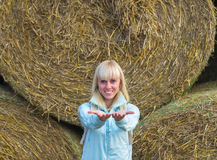 Beauty romantic girl outdoors against hay stack Stock Images