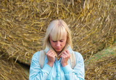 Beauty romantic girl outdoors against hay stack Royalty Free Stock Images