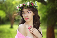 Beauty Romantic Girl Outdoors. Beautiful Teenage Model girl with. Flower chaplet at green park Stock Photo