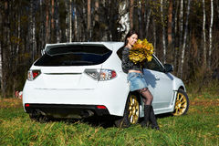 Beauty romantic girl and white stylish modern car Stock Photo