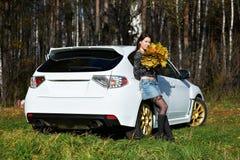 Beauty romantic girl and white stylish modern car stock photo