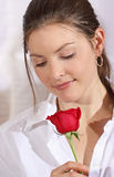 Beauty rose. Women looking rose during valentine day Royalty Free Stock Images