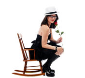 Beauty and the rose in a childs chair Stock Image